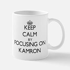 Keep Calm by focusing on on Kamron Mugs