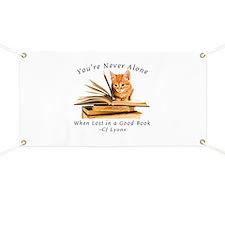 Kitten lost in books Banner