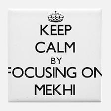 Keep Calm by focusing on on Mekhi Tile Coaster