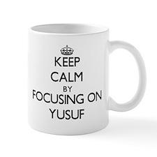 Keep Calm by focusing on on Yusuf Mugs