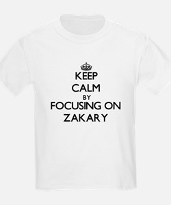 Keep Calm by focusing on on Zakary T-Shirt