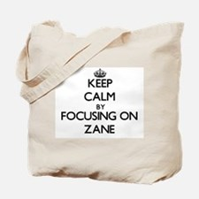 Keep Calm by focusing on on Zane Tote Bag