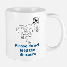 Dont feed the dinosaurs Mugs