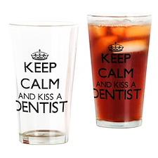 Keep calm and kiss a Dentist Drinking Glass