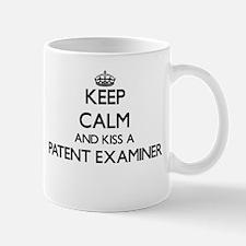 Keep calm and kiss a Patent Examiner Mugs