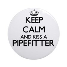 Keep calm and kiss a Pipefitter Ornament (Round)