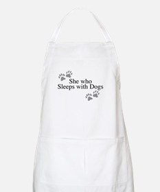 she who sleeps with dogs Apron