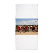 Old farm tractors machinery in country Beach Towel