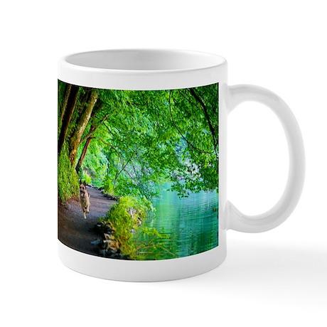 Quanna Running Along River Mugs