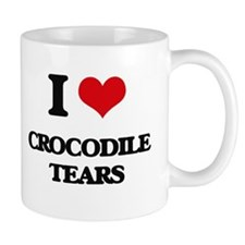 crocodile tears Mugs
