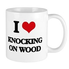 knocking on wood Mugs