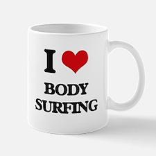body surfing Mugs