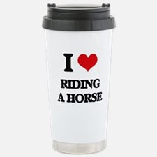 riding a horse Travel Mug