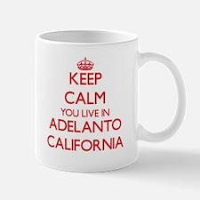 Keep calm you live in Adelanto California Mugs
