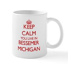 Keep calm you live in Bessemer Michigan Mugs