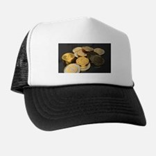 Bitcoins on a table Trucker Hat
