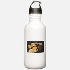 Bitcoins on a table Water Bottle
