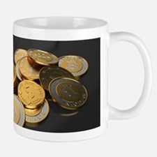 Bitcoins on a table Mugs