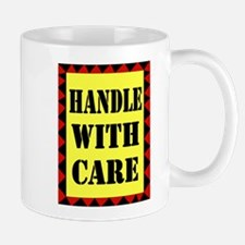 HANDLE WITH CARE Mugs