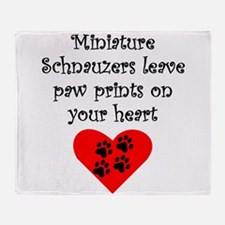 Miniature Schnauzers Leave Paw Prints On Your Hear