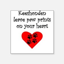 Keeshonden Leave Paw Prints On Your Heart Sticker