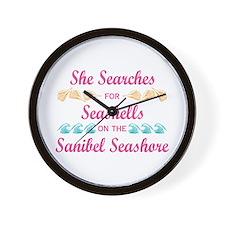 Sanibel shelling Wall Clock