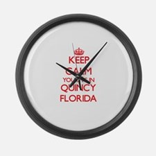 Keep calm you live in Quincy Flor Large Wall Clock