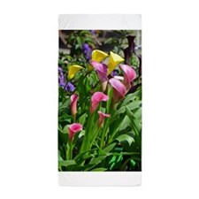 Colorful calla lilies in bloom Beach Towel