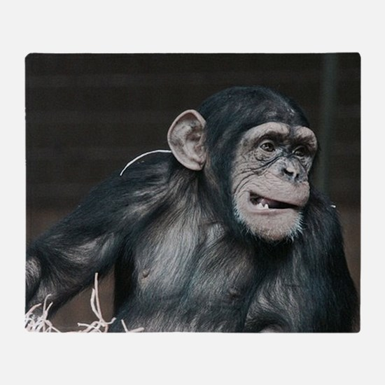 young chimpanzee Throw Blanket