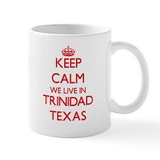 Keep calm we live in Trinidad Texas Mugs