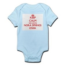 Keep calm we live in Nora Springs Iowa Body Suit