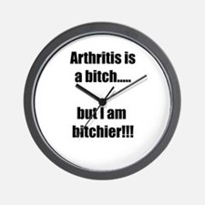Arthritis is a bitch..but I am bitchier Wall Clock