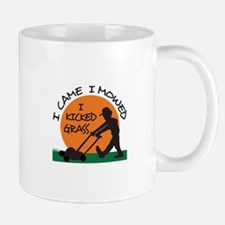 I KICKED GRASS Mugs