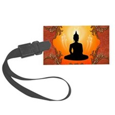 Buddha silhouette with glowing light and floral el