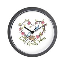 LOVE GROWS HERE Wall Clock