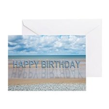 Birthday writing on a beach Greeting Cards