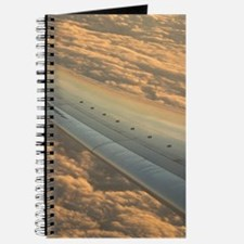Airplane flying in sky wing in flight  Journal