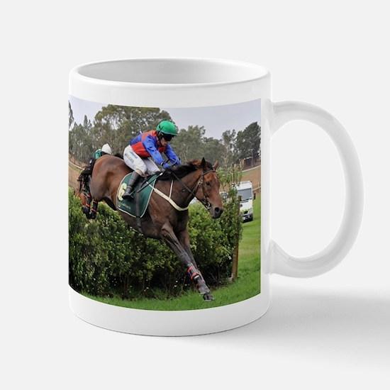 Racehorse and jockey jumping at steeplechase Mugs