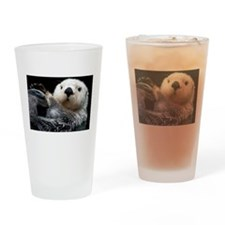 a cute otter Drinking Glass