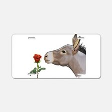 Mini donkey smelling a long stem red rose Aluminum