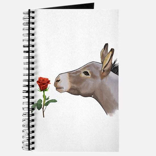 Mini donkey smelling a long stem red rose Journal