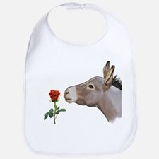 Mini donkey smelling a long stem red rose Bib