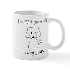 77 dog years 6 Mugs