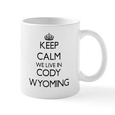 Keep calm we live in Cody Wyoming Mugs