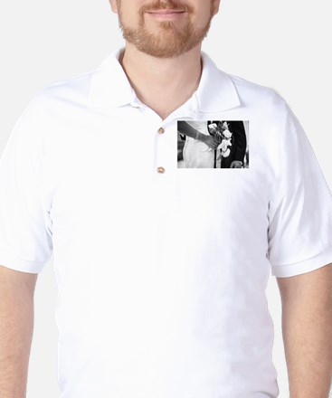 Bride and groom holding black and white Golf Shirt