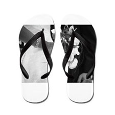 Bride and groom holding black and white Flip Flops