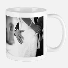 Groom holding bottom of bride black and white Mugs