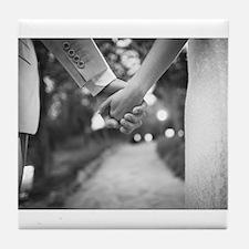Groom holding hands with bride black Tile Coaster