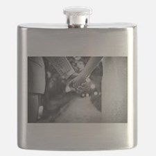 Groom holding hands with bride black and whi Flask