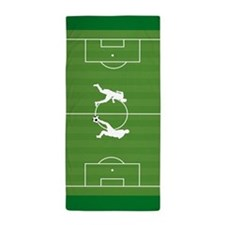 Soccer players on field Beach Towel